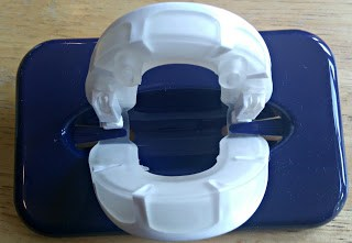 Snoreeze oral device clipped onto plastic case
