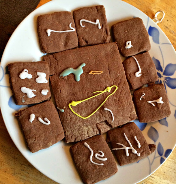 chocolate square biscuits with piped designs
