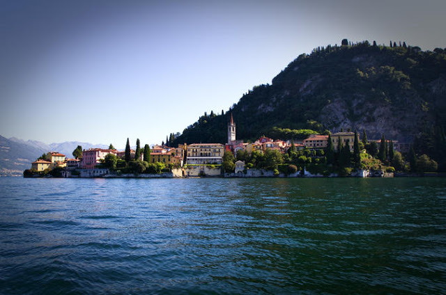 A view from the lake of the city of Verenna in Italy with a back drop of the Italian Alps