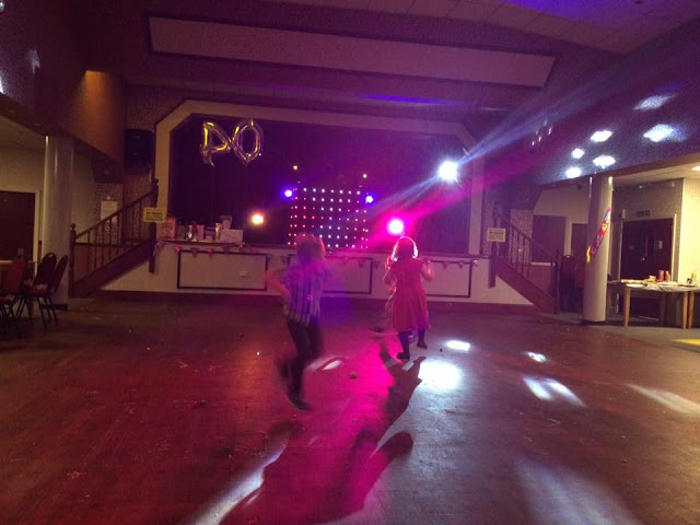 young children chasing the disco lights across the dance floor