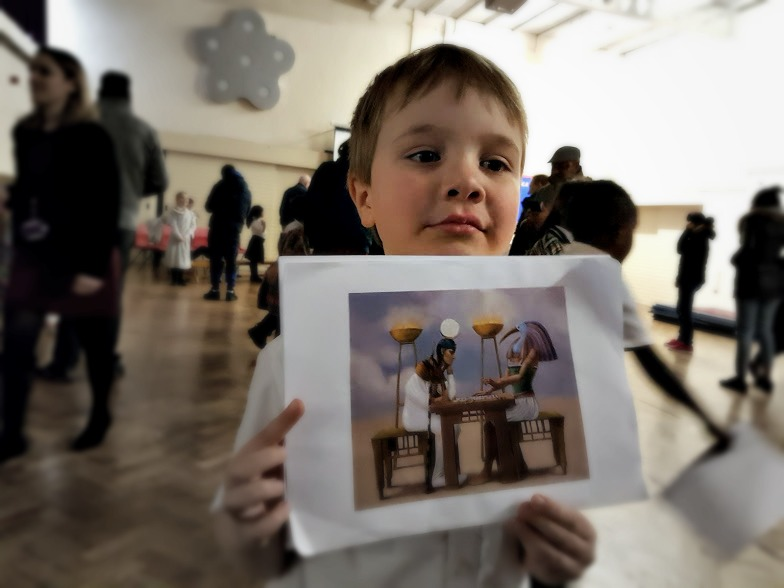 the little man at school with his picture of Egyptians playing senet