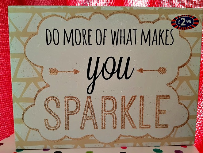 wooden board with the words 'do more of what make you sparkle'