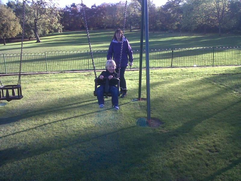 me pushing the little man on a swing in the park