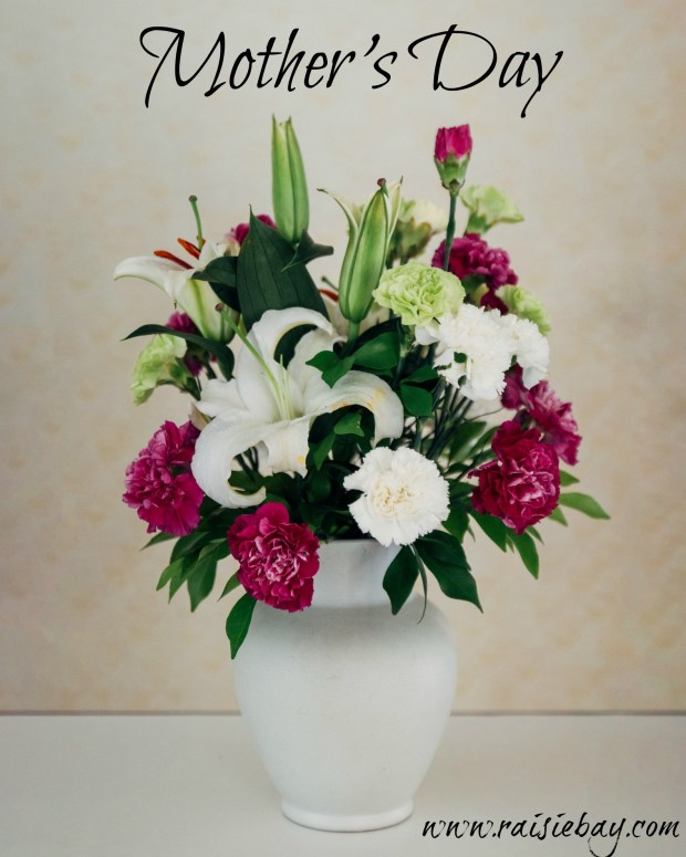 photo of a bouquet of pink and white flowers in a white vase and the words Mother's Day
