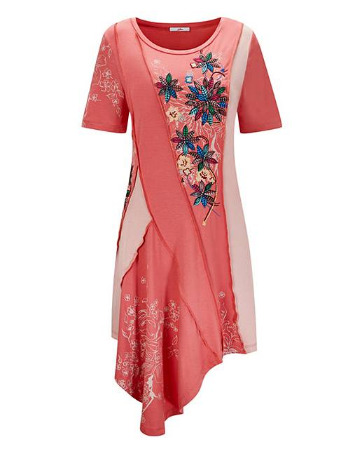 peach coloured top with embroidery