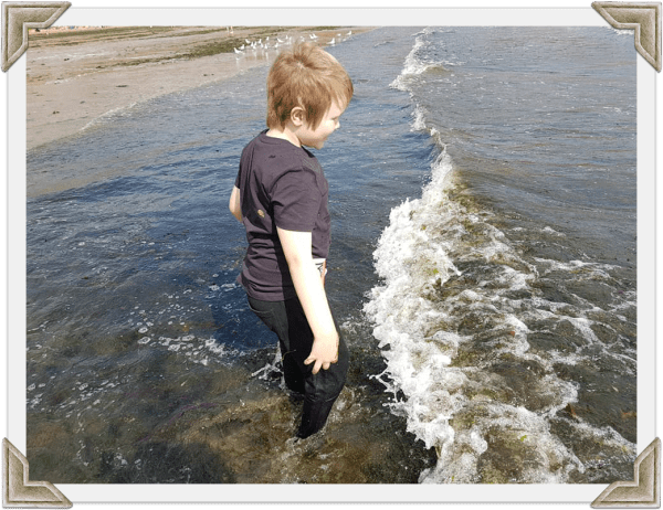 boy paddling in the sea taken in 2018