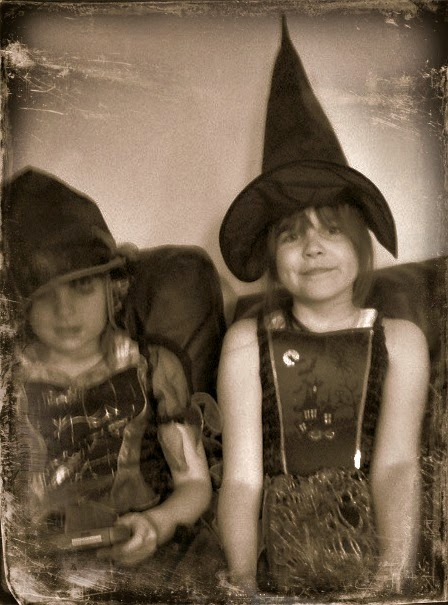 girls just wanna have fun, two little girls dressed up for trick and treating in witches outfits.