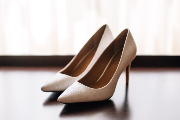 A pair of cream coloured high heeled shoes