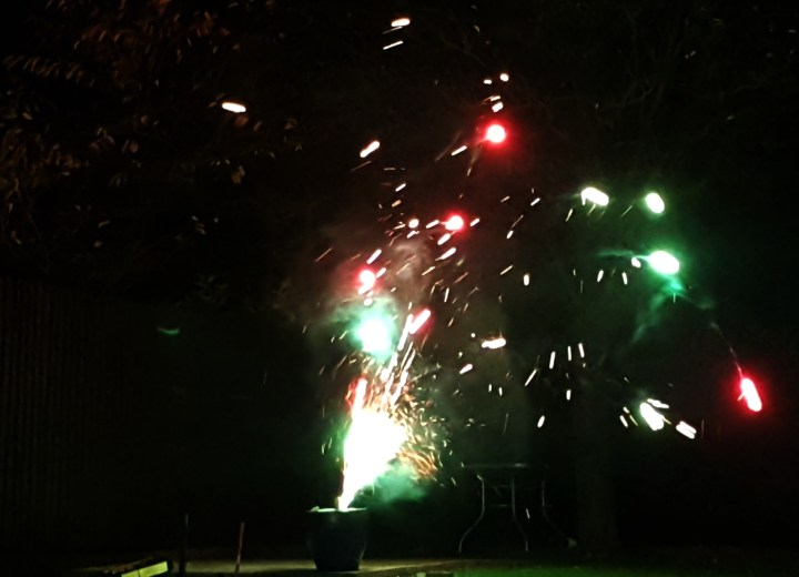 A dark image with the sparkle of a firework