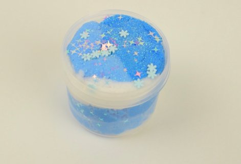 blue and white slime with sparkly snow flakes and stars from etsy