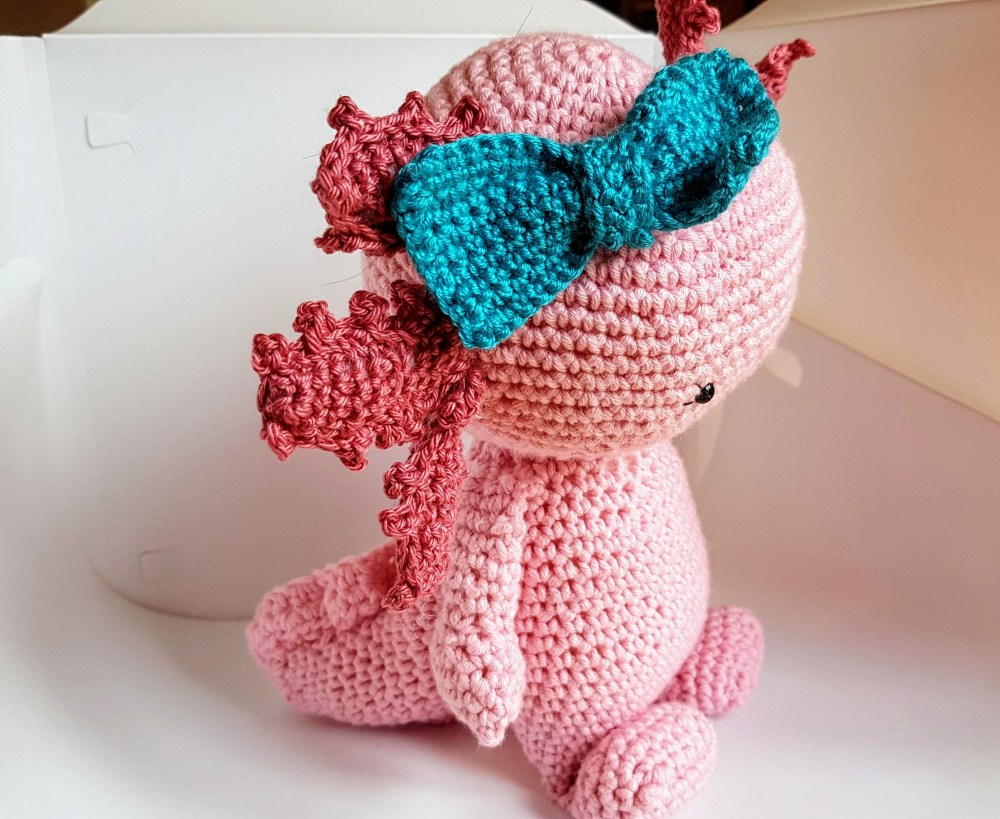 side view of the crochet axolotl