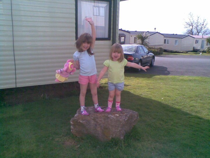 two little girls standing on a rock at a caravan park in 2010