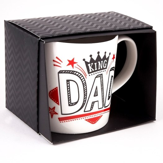 white mug in a black box. Mug says King Dad