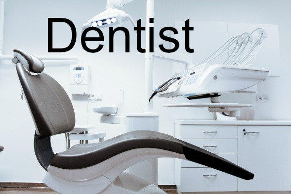 photograph of a black dentist chair in a very white clinical setting and the word Dentist