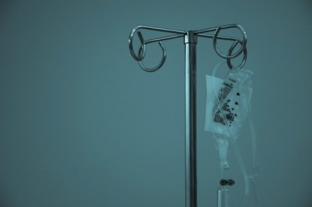 photo of a hospital drip holder with medication bag possibly cancer treatment