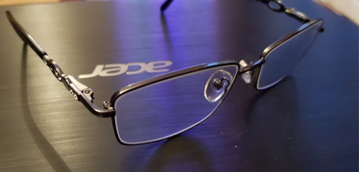 photograph of a pair of glasses on a laptop
