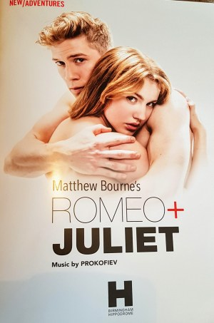 The cover of the program for Matthew Bourne's Romeo+Juliet featuring the two young lovers in an embrace.