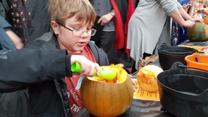 scooping the innards of the pumpkin