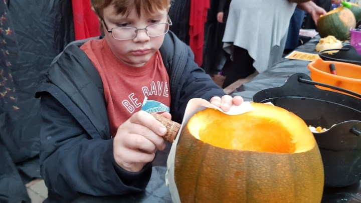 pinning the designe on the pumpkin