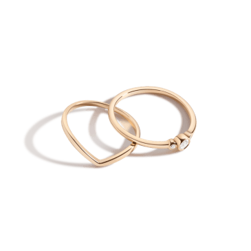 city lights stackable rings set, two elegant gold rings, one shaped and one with three diamonds.