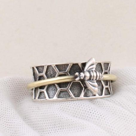 stirling silver ring with a bee on a honeycomb