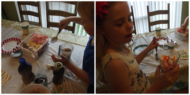 home economics, children making knickerbocker  glory desserts.