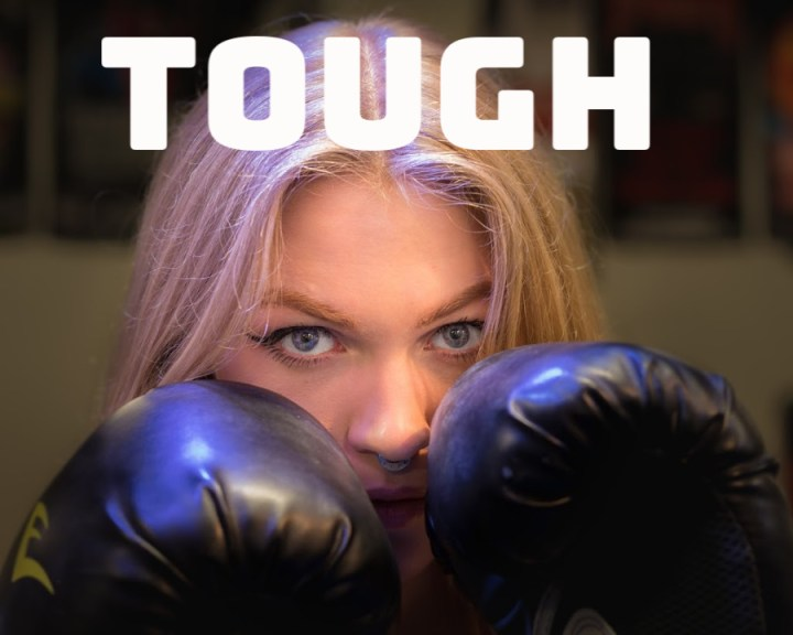 Tough, a woman with boxing gloves.