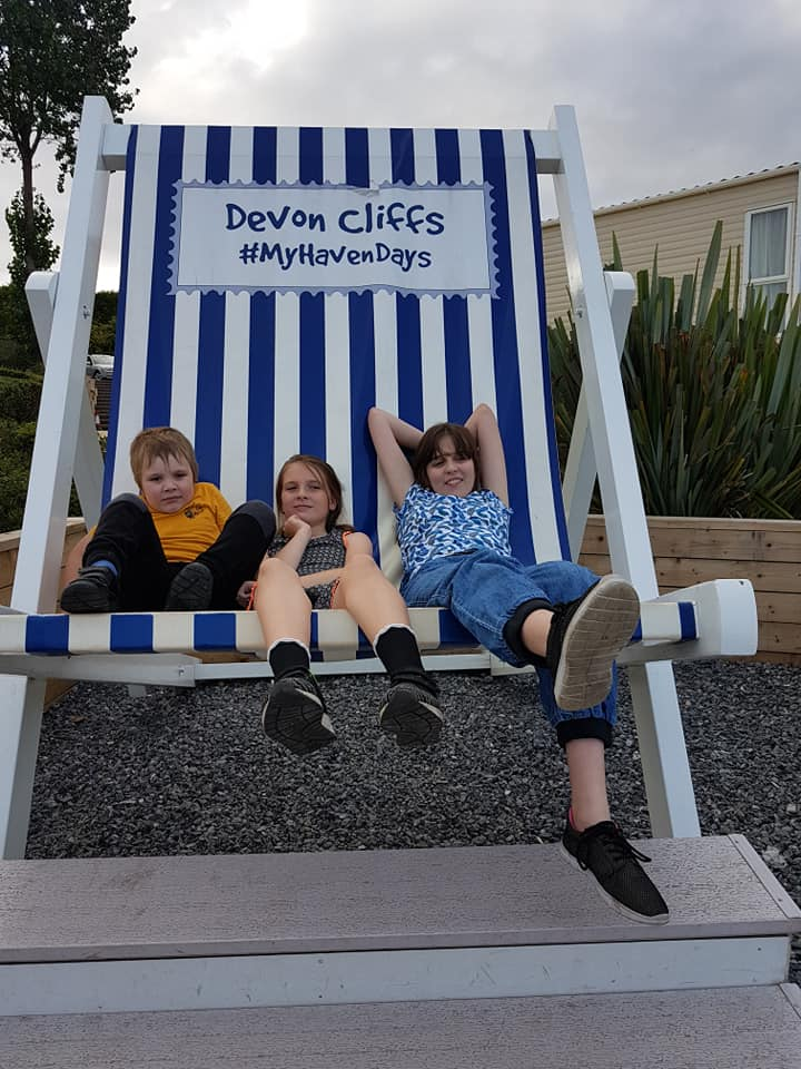 The Little Man, Boo and Star in the deckchair in Devon 2018