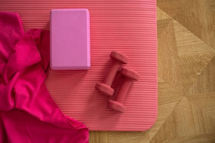 stay healthy with daily exercise, home gym equipment including exercise mat and dumb bells.