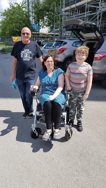 left behind - me in my wheelchair with my brother and my youngest son in a car park.