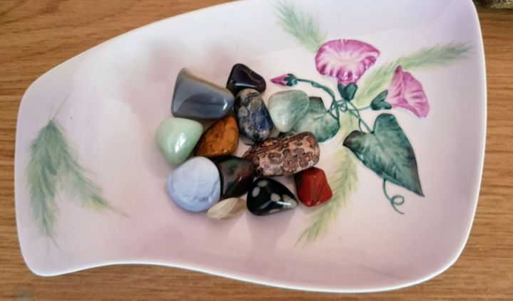 a white bowl with flowers and filled with crystals. August chronic illness writing prompts.