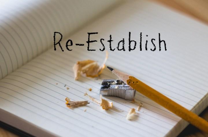 re-establish, a book and pencil with pencil sharpener