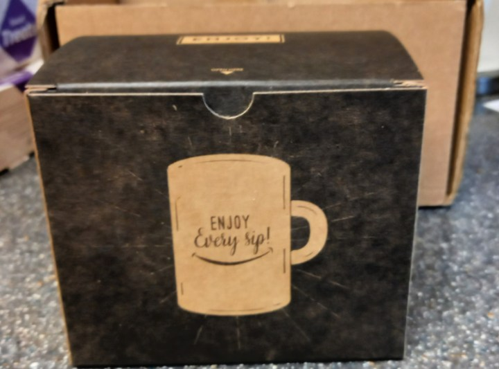 packaging box with 'enjoy every sip' written on it.