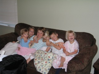 Family on couch in PJs