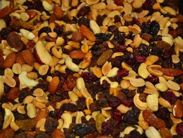 trail mix in golden colors: raisins, almonds, brazil nuts, peanuts cranberries and more