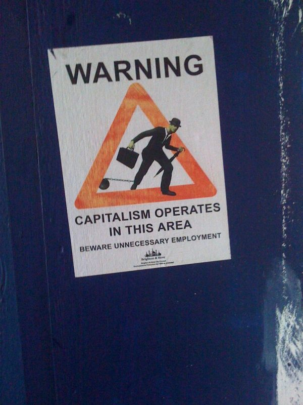 Poster: Warning: Capitalism Operates in this Area. Beware Unnecessary Employment.