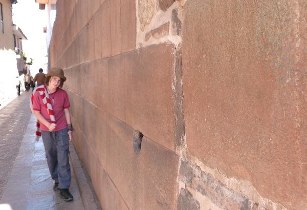 Miro walks along the walls of Coricancha
