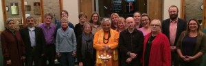 Participants at the multi-faith service. Hindu statesman Rajan Zed is behind the traditional lamp.