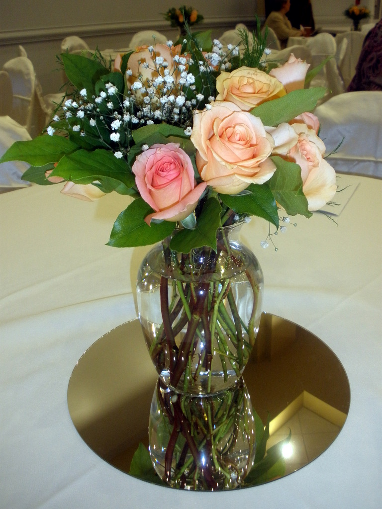 Wedding Centerpieces With Fresh Peach Roses And Greens