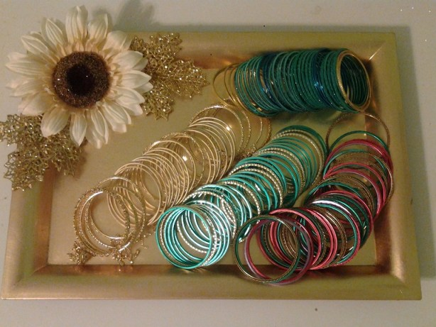 Decorated tray for bangles