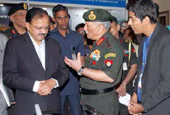 Army Chief General Bipin Rawat briefing the minister at the exhibition organised on the sidelines of the seminar