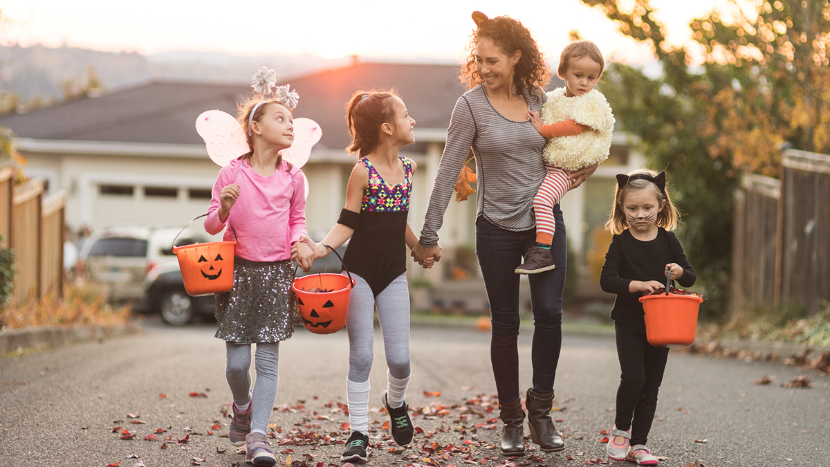 Mom trick or treating with young kids
