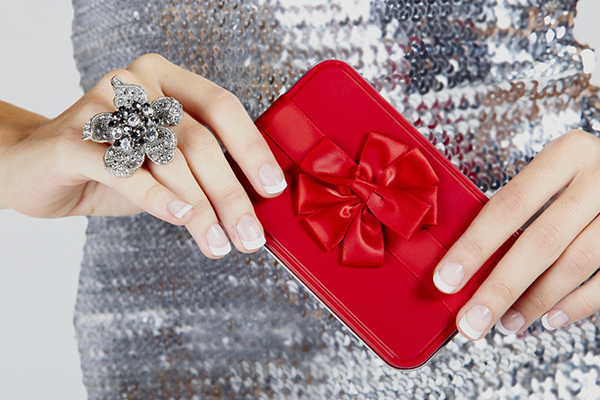 red gift box woman's hands