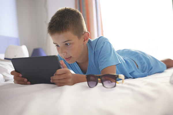 Boy reading on a tablet or iPad