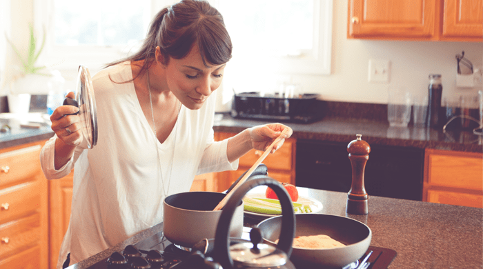 Woman cooking in kitchen alone