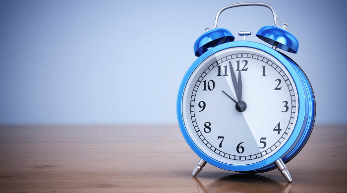 Blue alarm clock on table