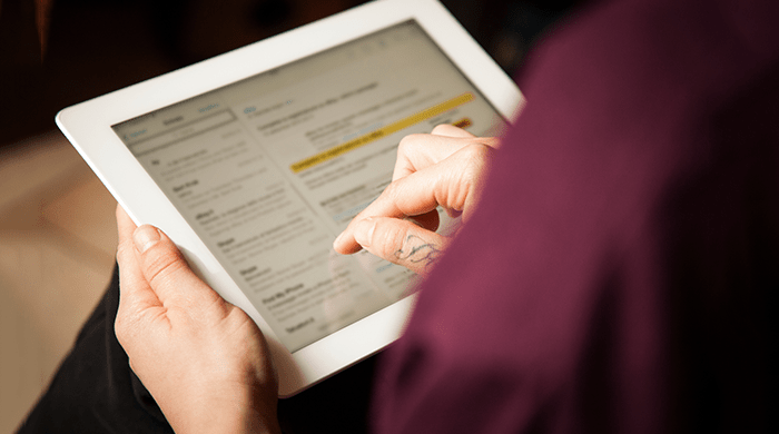 Woman checking email on iPad