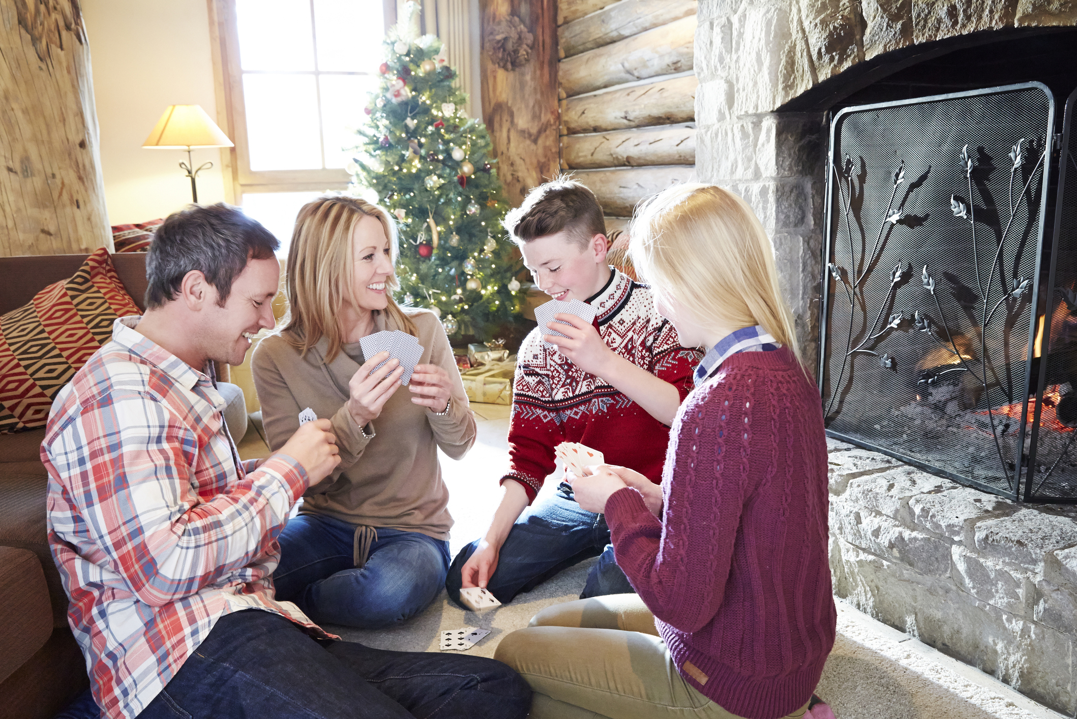 Family playing card game together