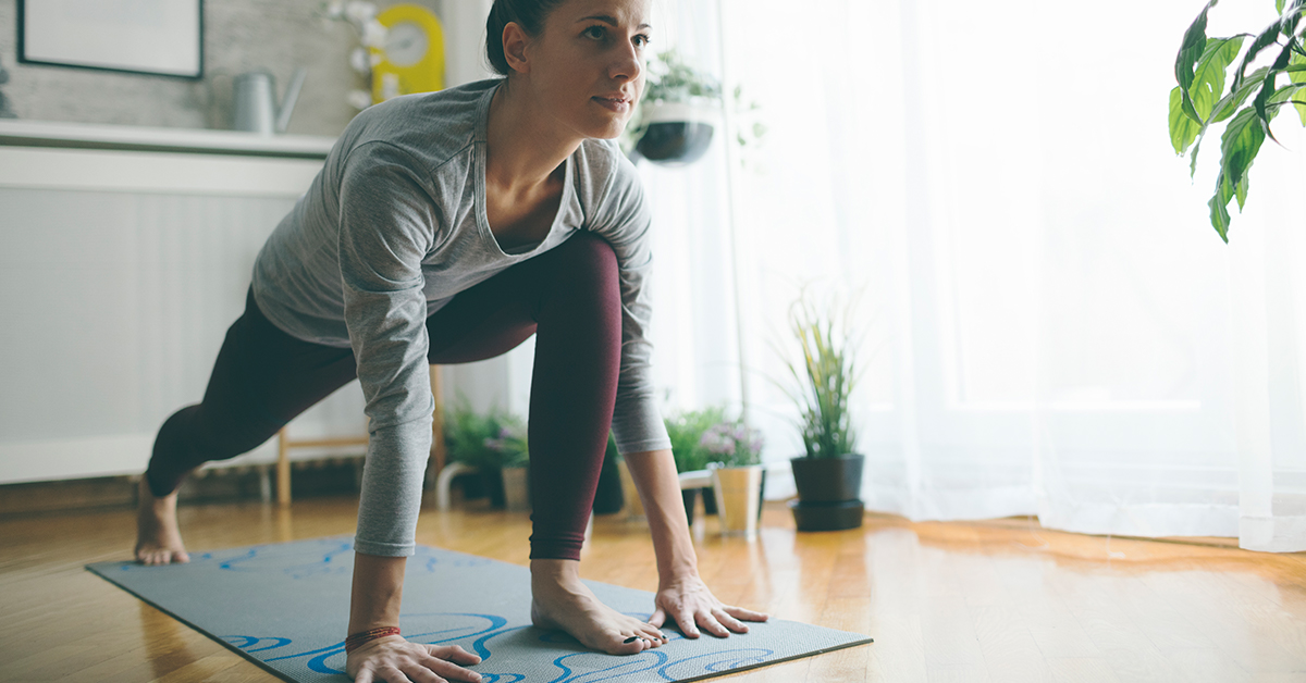 Girl stretching on a yoga mat