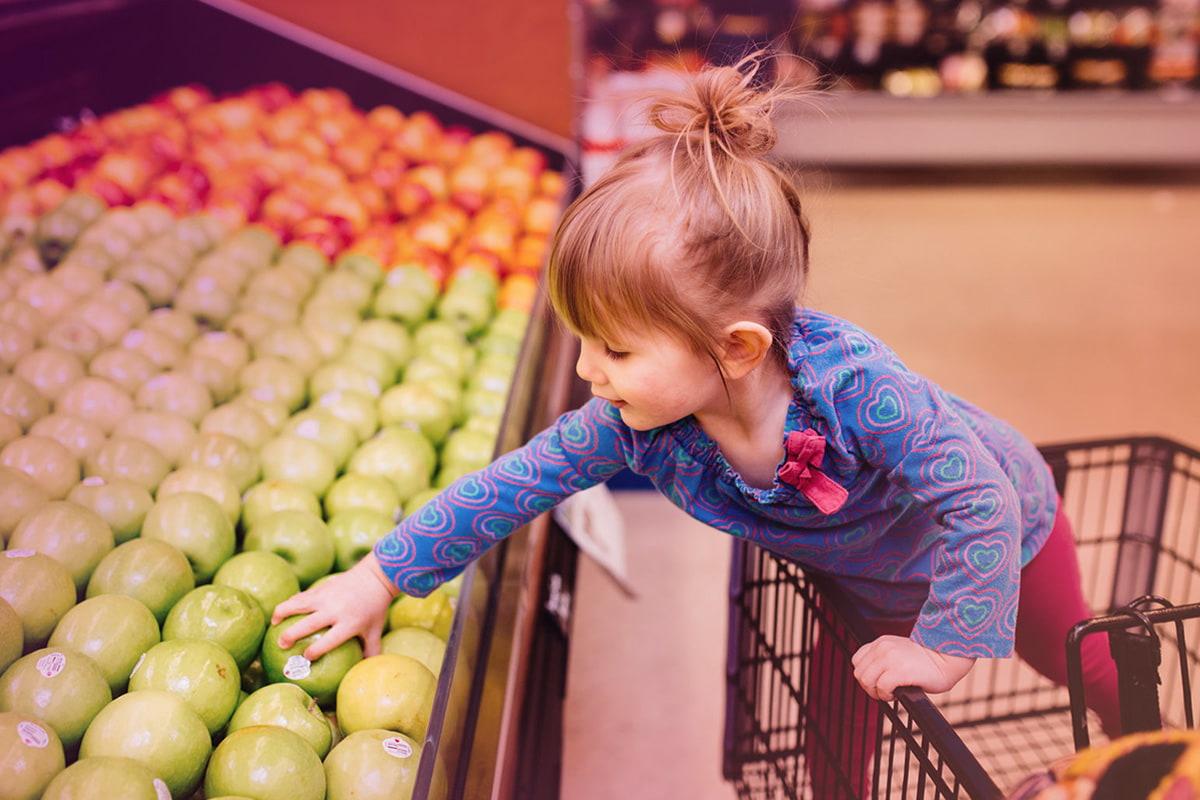 Little girl in a shopping cart
